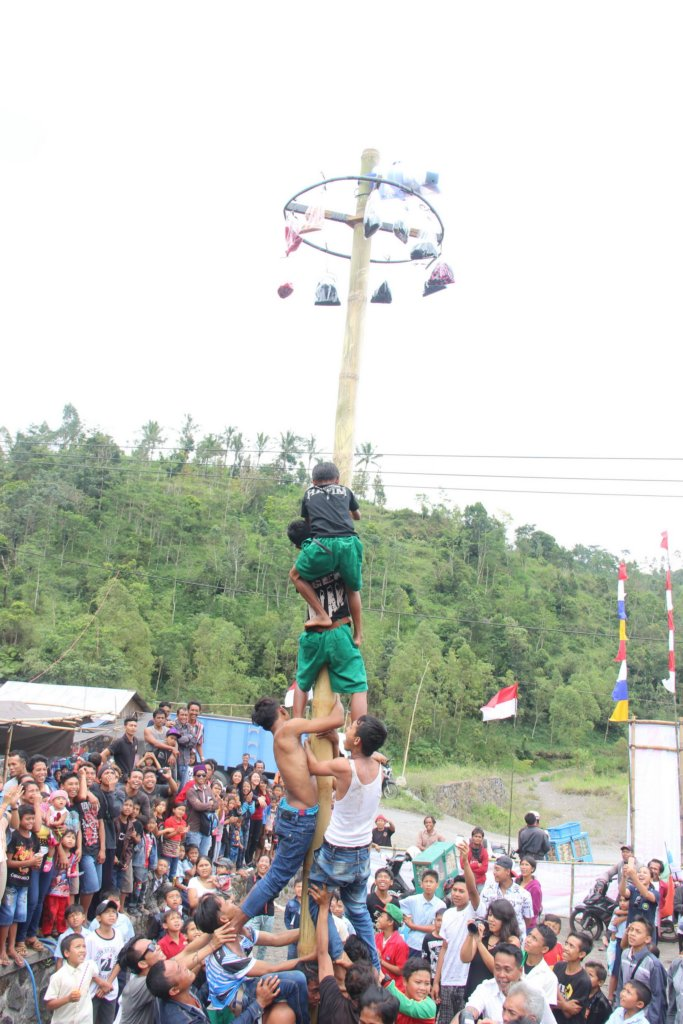 """Panjat Pinang"" climb up a slippery pole"