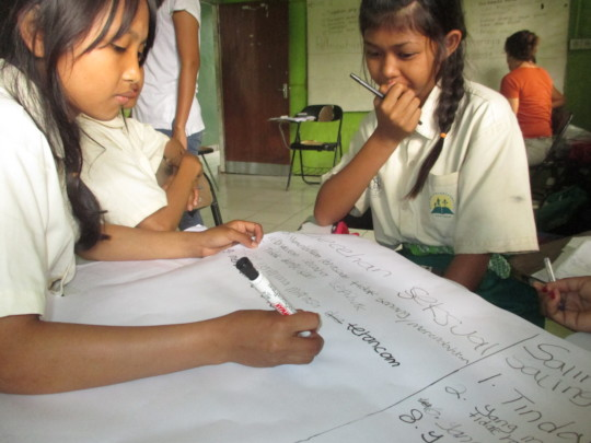 Students preparing sexual harassment poster