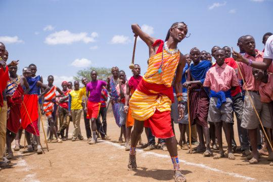 A Maasai warrior throws a rungu in competition