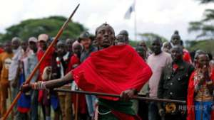 Maasai warrior competing in javelin event.