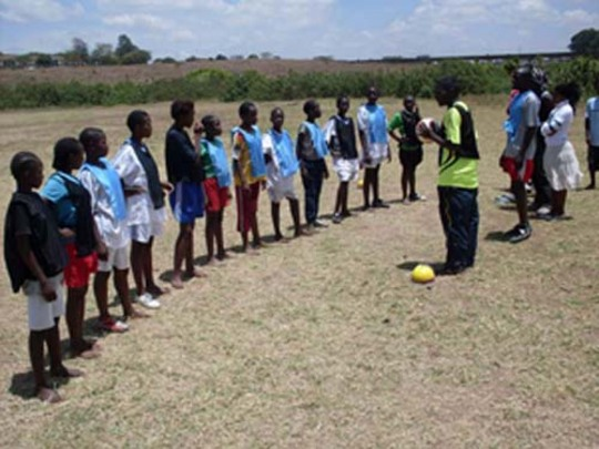 Coach Boniface instructing the girls during the training