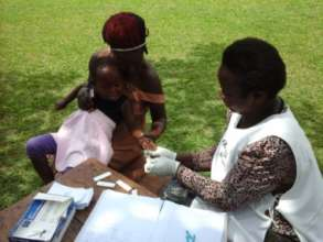 Taking blood samples to test for Malaria