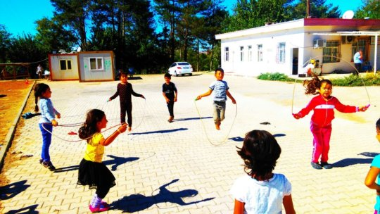 Children enjoying the weather at the camp.