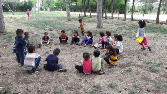 Children playing games and enjoying the weather.
