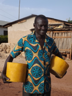 Osuwu with his recent harvest of beeswax