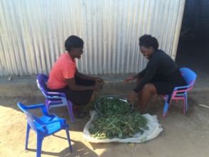 Our caretakers Mary and Nancy preparing vegetables