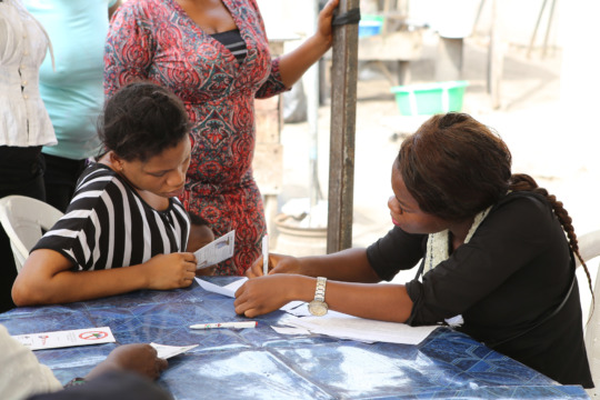 Programme recipient filling out a questionnaire