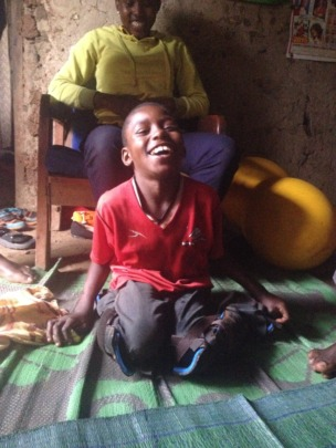 12-year-old Emmanuel sits by his mother