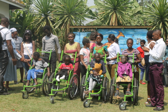 The families with their new wheelchairs