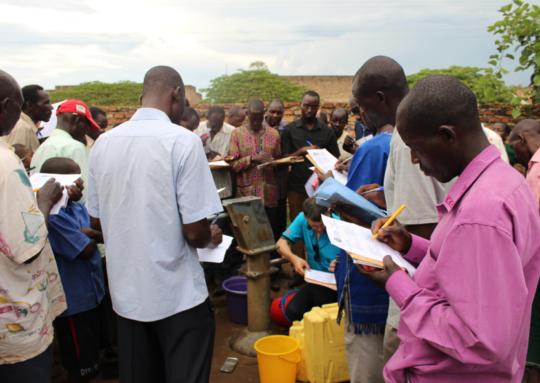 Mechanics assess a well in Apac, Uganda