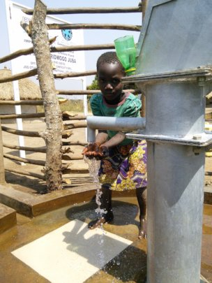Collecting water for the first time in Aberidwogo