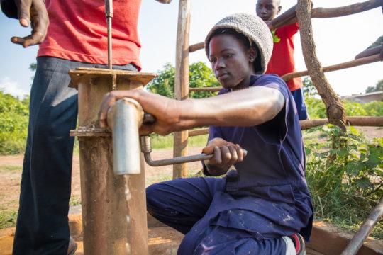 Broken water well being repaired.