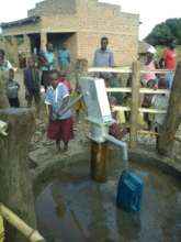 New hand pump at a well in Igoti