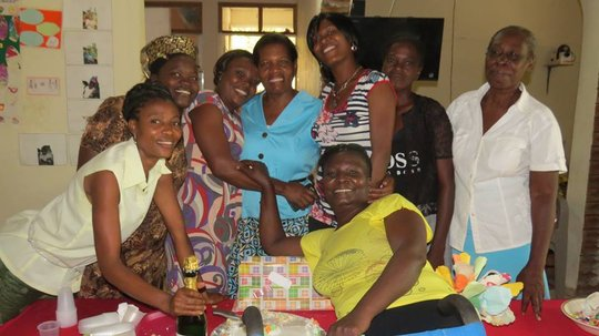 Mdm Woo Woo and the staff during her leaving party