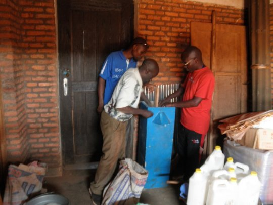 Educators building a water filter system a school