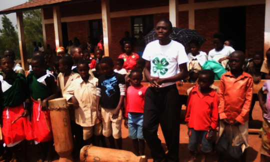Burundi 4-H educator working with students