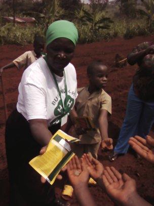 Ag consultant handing out seeds to youth