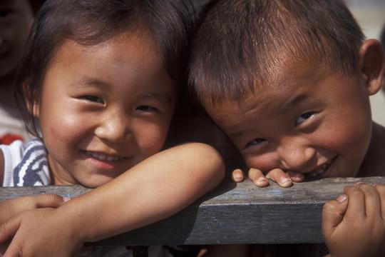 Two North Korean children smile for the camera