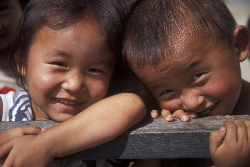 Two North Korean children smile for the camera