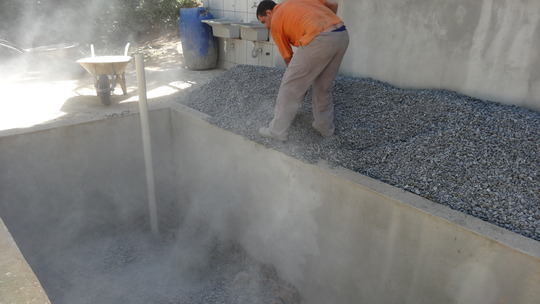 Filling evapotranspiration basin with fine grit