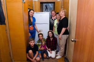 Presenting fridge to Roman and Olga large family