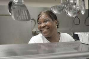 Deborah volunteers in the kitchen