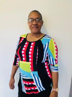 Alumnus Carlita reaches back; helps the next woman