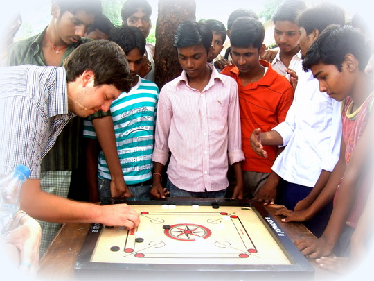 Shaun playing carrom with boys at the remand home