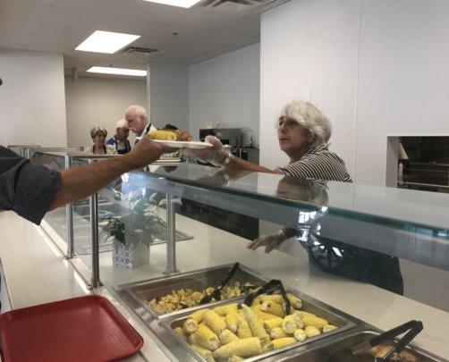 Volunteer serving dinner last week