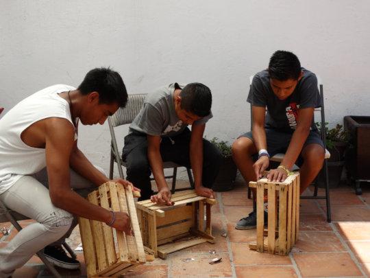 Skilled young men during a handcraft workshop