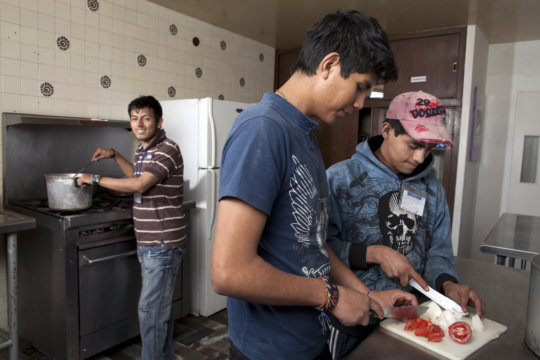 Youth House residents cooking together