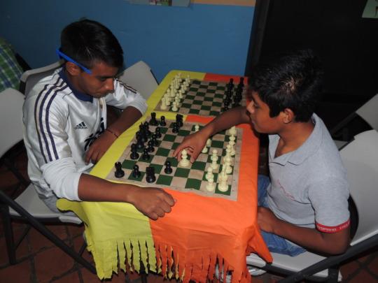 Strategic thinking: youths playing chess