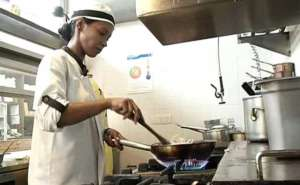 Lily cooking at Tres Restaurant
