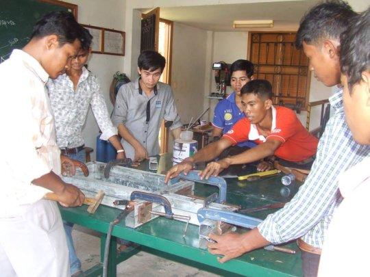 Nang, center, in shop class