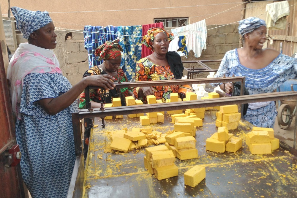 Making soap at a local women