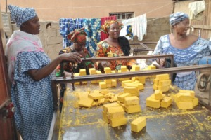 Making soap at a local women's association