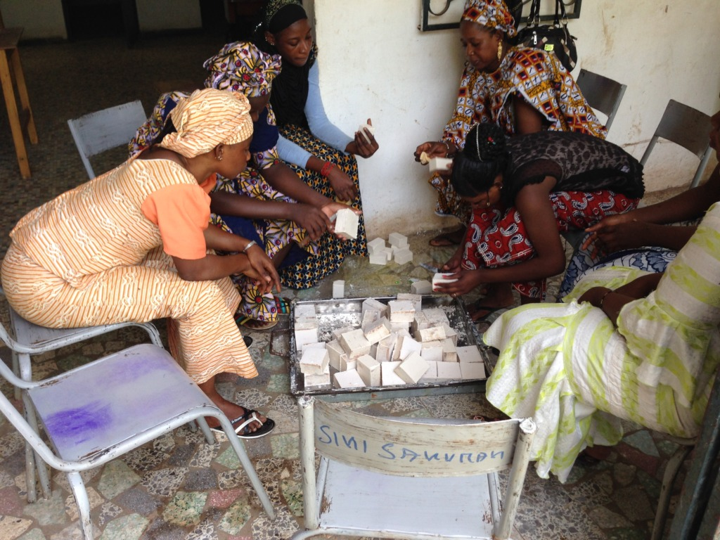 Bagging shea butter soap - a communal activity!