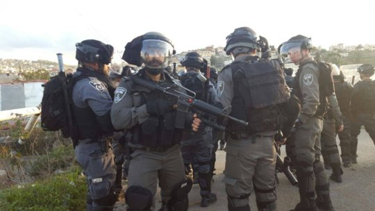 Riot police at Ar
