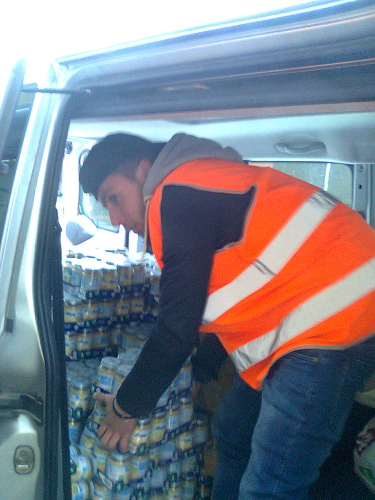 Volunteer helping with transfering of goods