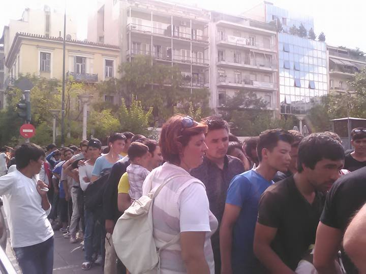 Refugees queuing for common meals