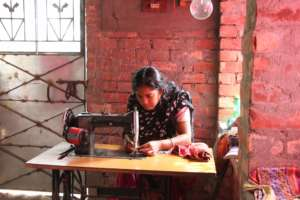 Sabir's wife with her sewing machine