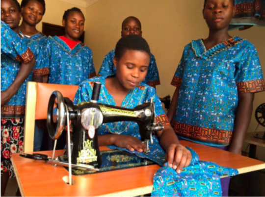 A young woman working at a new sewing machine