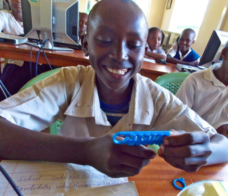 A student admires his key chain design