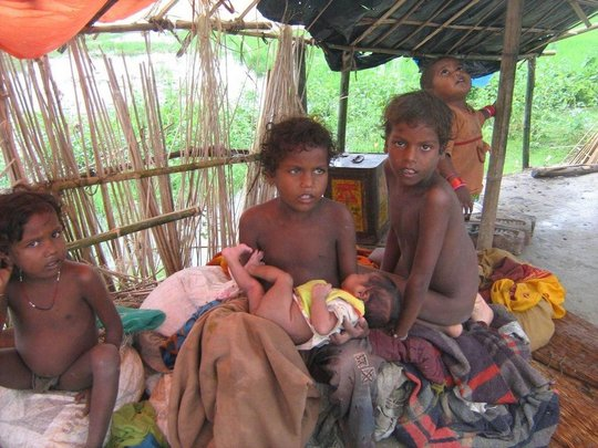 Children wait patiently while in camp