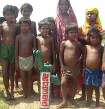 Children pose proudly by new well
