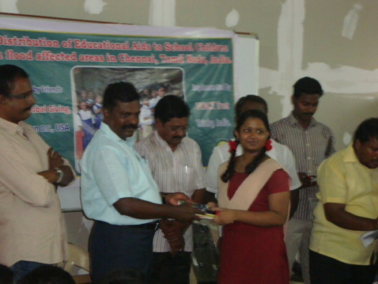 Thol. Thirumavalavan distributing edu aids to girl