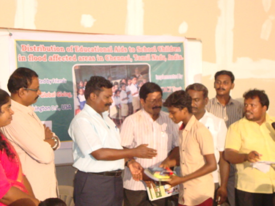 Thol. Thirumavalavan distributing edu aids to boy