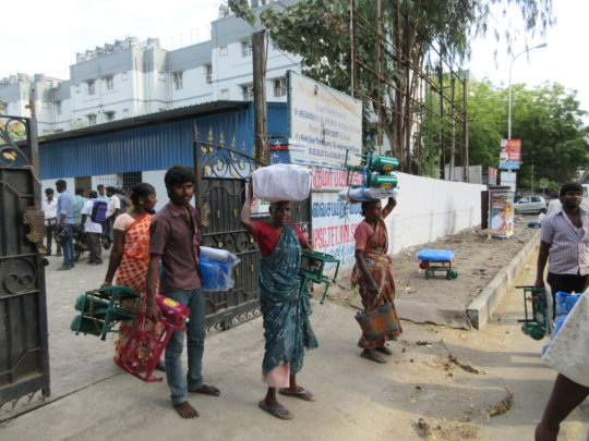 People carrying relief goods to their homes