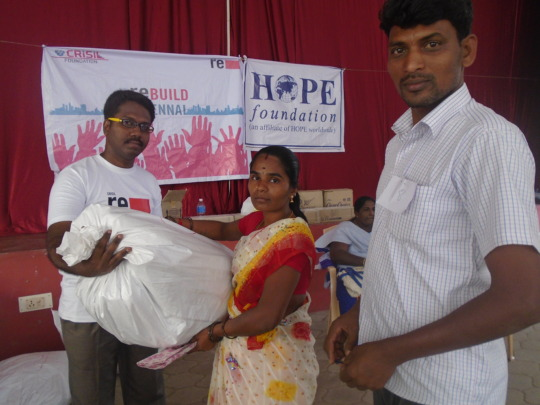 Handing the relief kit to the Flood Victim