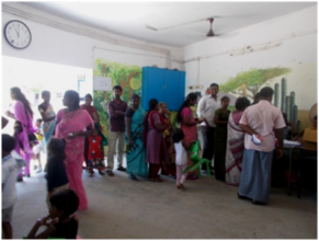 Parents standing in a queue for registration